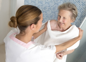 caregiver helping the elderly woman to take a bath