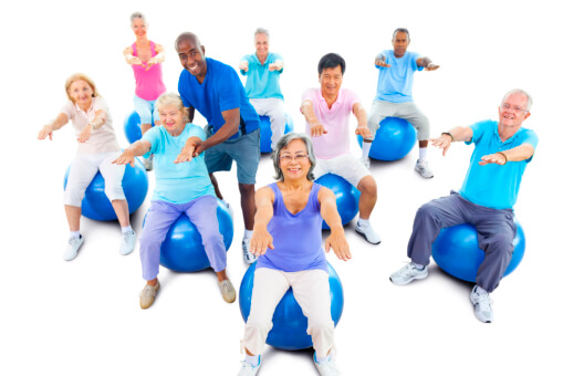 Group Of Multi-Ethnic Senior Adults Exercising Yoga With The Ins